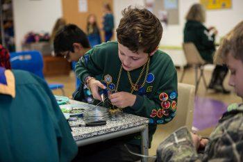 Cub making jewellery